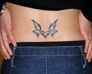 lower back tattoo heart and wings
