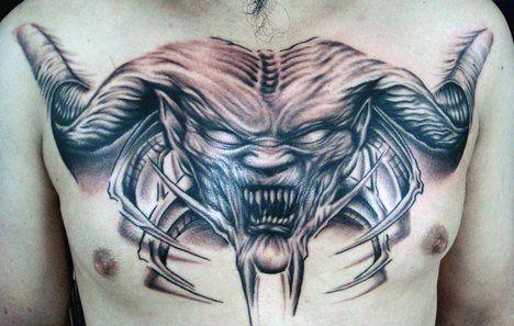 demon chest tattoo