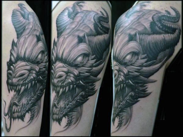 tatuaże smoki głowa
