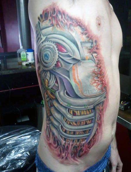 biomechanical tattoo idea for man