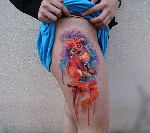 colorful fox tattoo on thigh