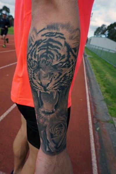 tatuaże zwierząt tygrys i róża