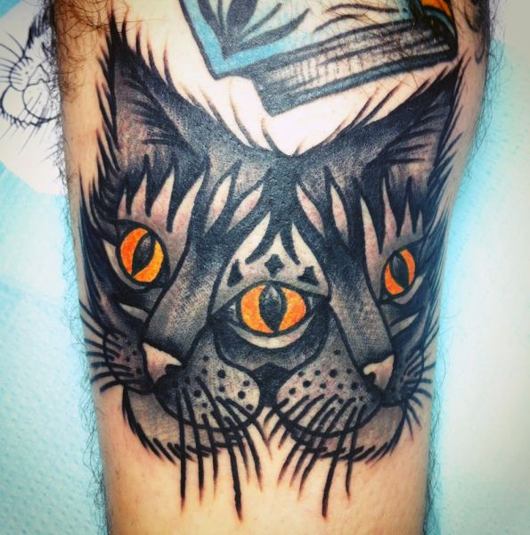 double cat head tattoo