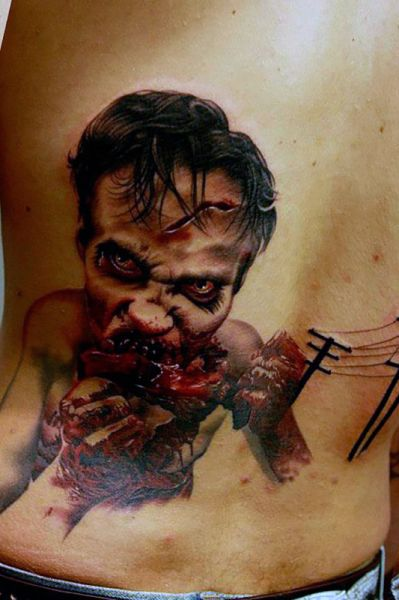 lower back tattoo zombi