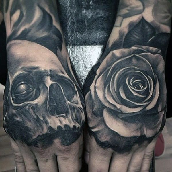 rose and skull tattoo on hands