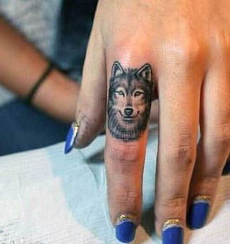 wolf finger tattoo