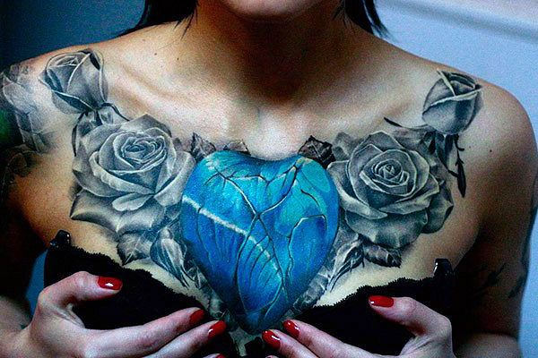 women chest tattoo heart and roses