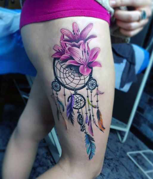 dreamcatcher and lily thigh tattoo