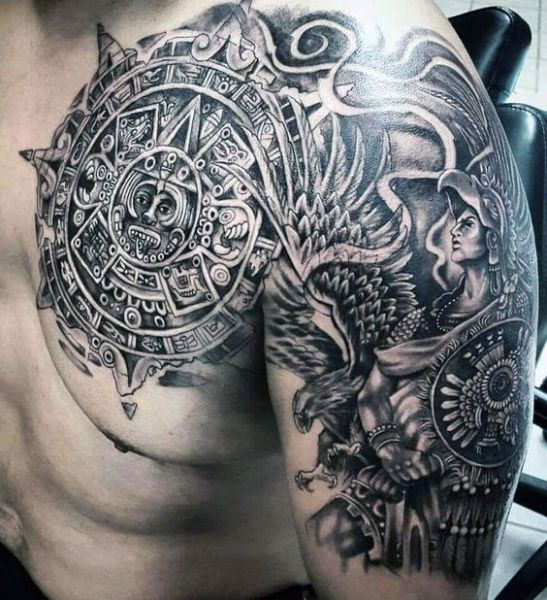 aztec chest and arm tattoo