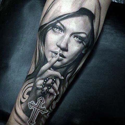 women with rosary tattoo