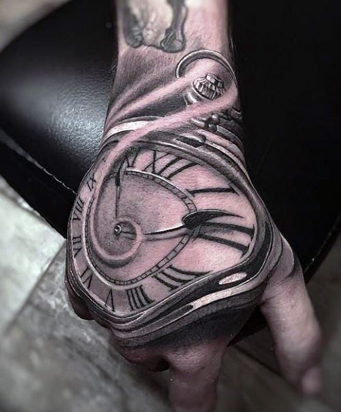 incredible clock on hand tattoo