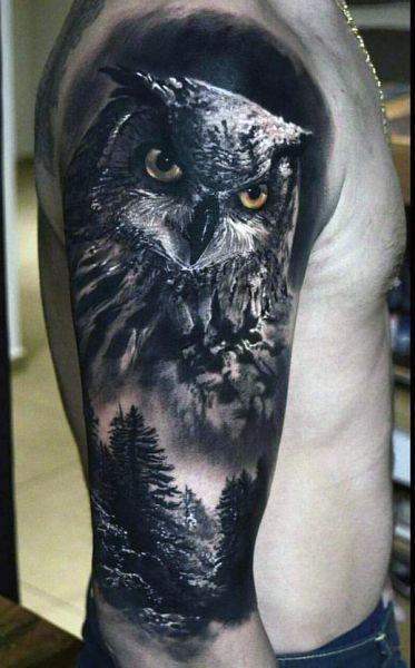 amazing owl arm tattoo