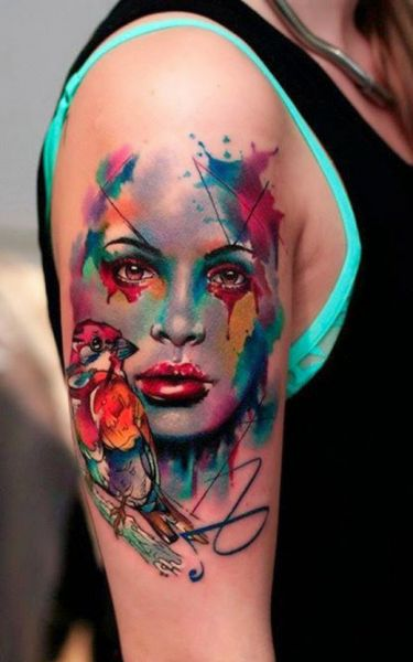 colorful tattoo face and bird