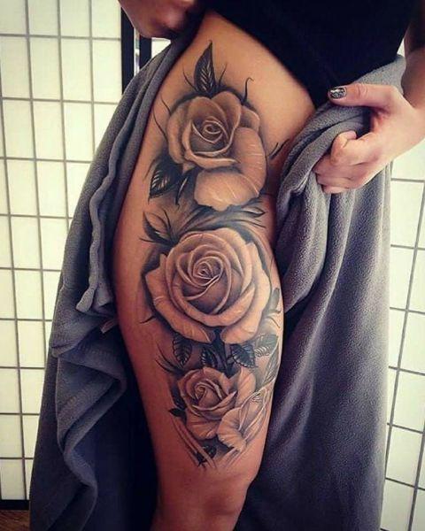 róże na biodrze tatuaże damskie