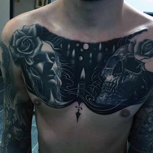 chest tattoo woman and skull