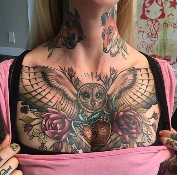 owl and flowers chest tattoo