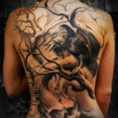 lower back tattoo skull and crow