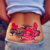 lower back tattoo flowers lotus