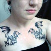 bats chest tattoo