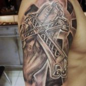 cross shoulder tattoo