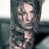 woman with gun tattoo
