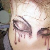 crying eyes neck tattoo