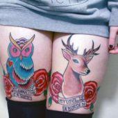 tatuaże na udach sowa i jeleń