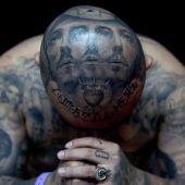 tatuaże męskie na głowie