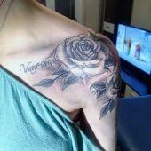woman rose arm tattoo