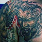 devil arm tattoo