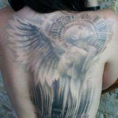 tatuaże damskie anioł i zegar
