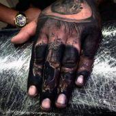 amazing skull hand tattoo