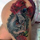 tatuaże damskie sowa na udzie