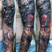 tatuaże męskie smok na ramie