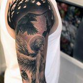 tatuaże męskie anielica i kruki