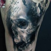 skull and butterfly thigh tattoo
