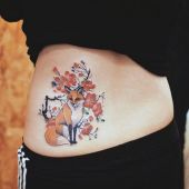 lower back tattoo fox