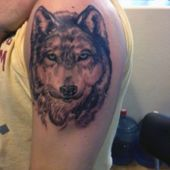 wolf men arm tattoo