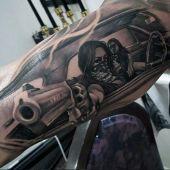 women with gun tattoo