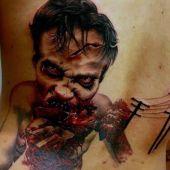 lower back tattoo zombi