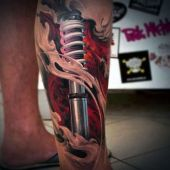 amazing biomechanical leg tattoo