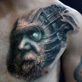 biomechanical face man tattoo