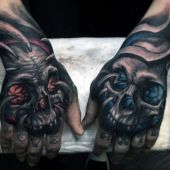 amazing skull on hand tattoo
