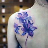 beauty tattoo on shoulder