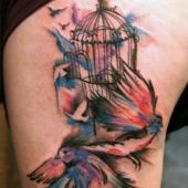 colorful bird thigh tattoo