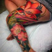 leg tattoo flowers