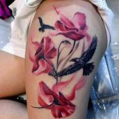 thigh tattoo flowers and crows