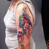 colorful bird arm tattoo