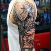 owl and skull arm tattoo