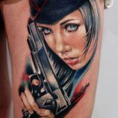 thigh tattoo woman with gun